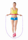 Jumping girl young with a skipping rope Stock Image