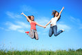 Jumping girls fun young outdoors Royalty Free Stock Image