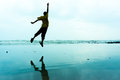 Jumping of happiness near the beach Stock Image