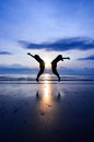 Jumping of happiness when sun rising near the beach Royalty Free Stock Photos