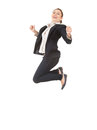 Jumping happy businesswoman in dark jacket Stock Photography