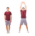 Jumping Jacks. Young man doing sport exercise. Royalty Free Stock Photo