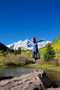 Jumping for joy at maroon bells a girl jumps in freedom and wonder the scenic aspen colorado in fall Stock Image
