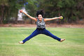 Jumping for joy over healthy food attractive hispanic teenage girl holding a red apple and a green apple Royalty Free Stock Photography