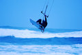 Jumping kite surfer on blue background Stock Images