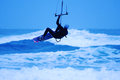 Jumping kite surfer on blue background Stock Image