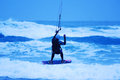 Jumping kite surfer on blue background Royalty Free Stock Photo