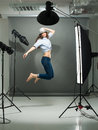 Jumping model portrait of a working in the professional photo studio Royalty Free Stock Photo