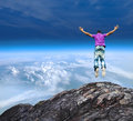 Jumping off a mountain cliff guy with casual cloths Royalty Free Stock Photo