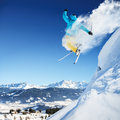 Jumping skier in high mountains at jump Stock Photos