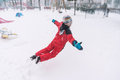Jumping in snow happy carefree kid winter joy Royalty Free Stock Images