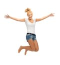 Jumping teenage girl in blank white t shirt picture of Royalty Free Stock Images