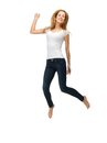 Jumping teenage girl in blank white t shirt picture of Royalty Free Stock Photography