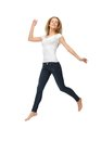 Jumping teenage girl in blank white t shirt picture of Stock Photo