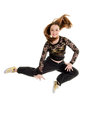 Jumping teenage hip hop dancer pretty and happy in air Stock Images