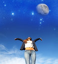 Jumping to the stars a young woman night sky Royalty Free Stock Image