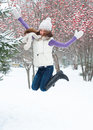 Jumping winter woman Stock Image