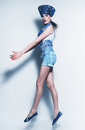 Jumping woman in blue denim shorts and waistcoat studio Royalty Free Stock Image