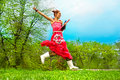 Jumping woman on green grass Royalty Free Stock Photo