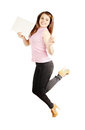 Jumping woman holding a piece of paper Royalty Free Stock Photos