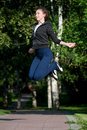 Jumping woman with skipping rope at park Royalty Free Stock Image