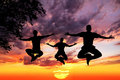 Jumping Yoga silhouettes in lotus Royalty Free Stock Photo
