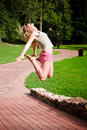 Jumping young woman Royalty Free Stock Image
