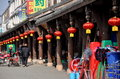 Jun le chin wooden arcade with new year lanterns a housing various shops is hung red for the chinese lunar holiday in china Royalty Free Stock Images
