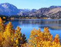 June lake with fall foliage the colors were gorgeous on this day especially against the deep blue you can drive around the the Stock Images