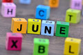 June word on table Royalty Free Stock Photo
