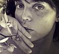 Junge Frau und Orchidee Stockfotos