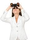 Junge geschäftsfrau looking through binoculars Stockfoto
