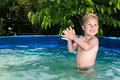 Junge im pool boy at the pool little happy playing in Royalty Free Stock Image