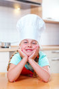 Junior cook smiling portrait of in modern kitchen Stock Image