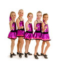 Junior girls tap dance team young in recital competition costumes Stock Photography