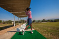 Junior player golf practice range male teenager under eighteen years practicing shots prior to south african national Stock Image