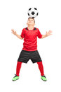 Junior soccer player joggling with a ball full length portrait of isolated on white background Stock Photos