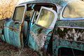Junk car old and rusted sits abandoned Royalty Free Stock Images