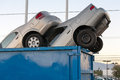 Junk cars in dumpster cash for clunkers a Stock Photo
