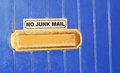 Junk mail no sign on blue door Royalty Free Stock Image