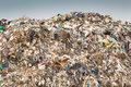 Junk yard hill of diverse domestic garbage in landfill Royalty Free Stock Image