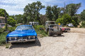 Junk yard with old beautiful orderville usa july oldtimers on the route on july in orderville usa america is a spot for european Royalty Free Stock Photos