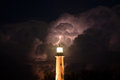Jupiter inlet lighthouse during a lightning storm that went through palm beach county at the with strike in the background Royalty Free Stock Photos