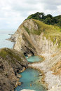 Jurassic coast of dorset rock formations and inlets on the at lulworth cove england Royalty Free Stock Images