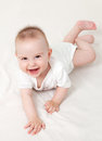 Just adorable months old baby smiling Stock Photo