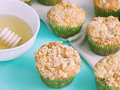Just baked apple muffins with butter crumb spiced on on green pastel wooden table beige table napkin Royalty Free Stock Image