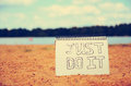 Just do it notebook with words its a good for motivation sketch in notebook this is look good on nature background Royalty Free Stock Image