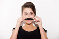 Just having fun beautiful young short hair woman holding fake mustache on her face and smiling Stock Photography