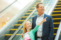 Just look over there cheerful father and daughter moving down by escalator while little girl pointing away and smiling Stock Photography