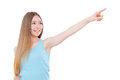 Just look over there happy teenage girl pointing away and smiling while standing isolated on white Royalty Free Stock Photos